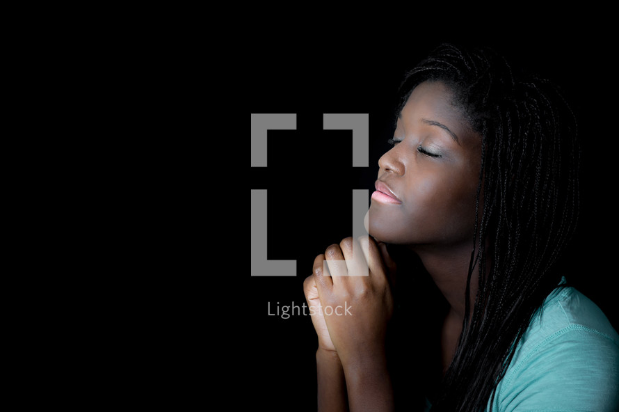 Teen girl in prayer