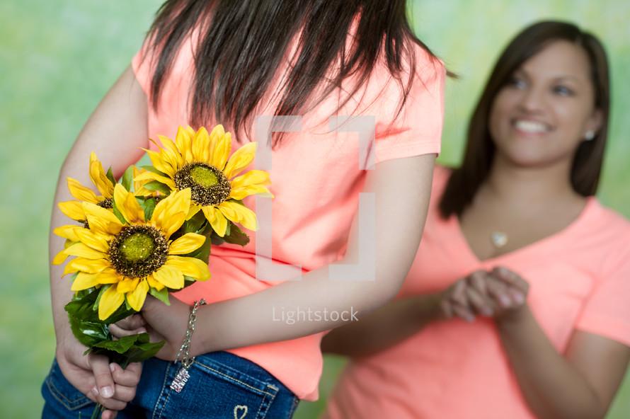 daughter handing her mother flowers