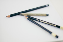 black pencils on a white background
