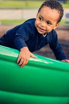 Boy on a playground slide.