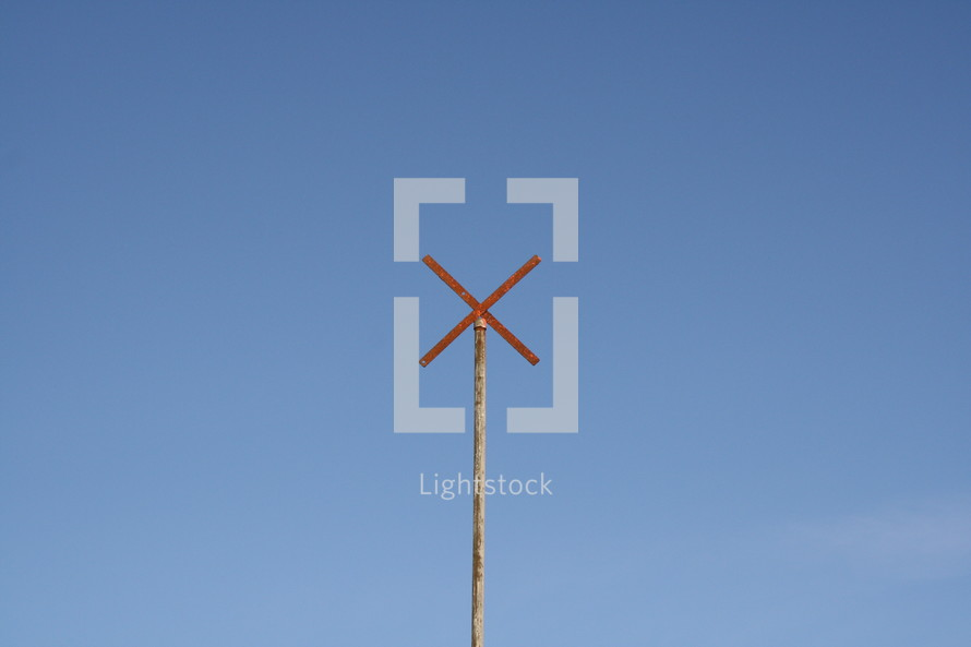 single pole with x on top  - sky