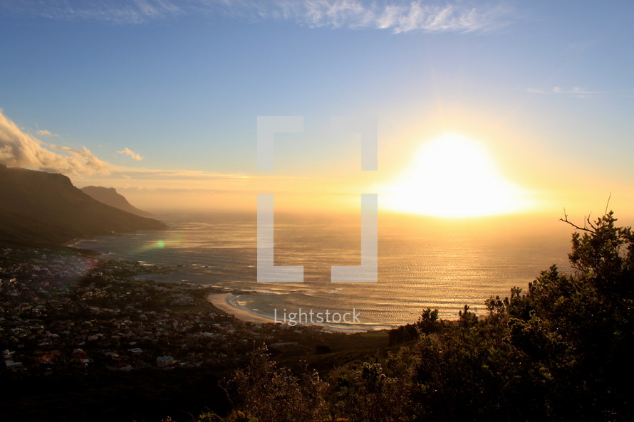 large sunburst over ocean water