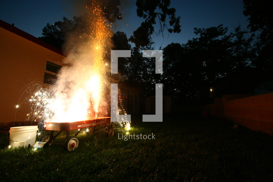 fireworks exploding in a red wagon