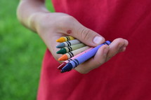 hands holding crayons
