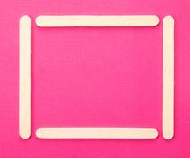 popsicle stick frame on fuchsia