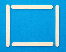 popsicle frame on blue