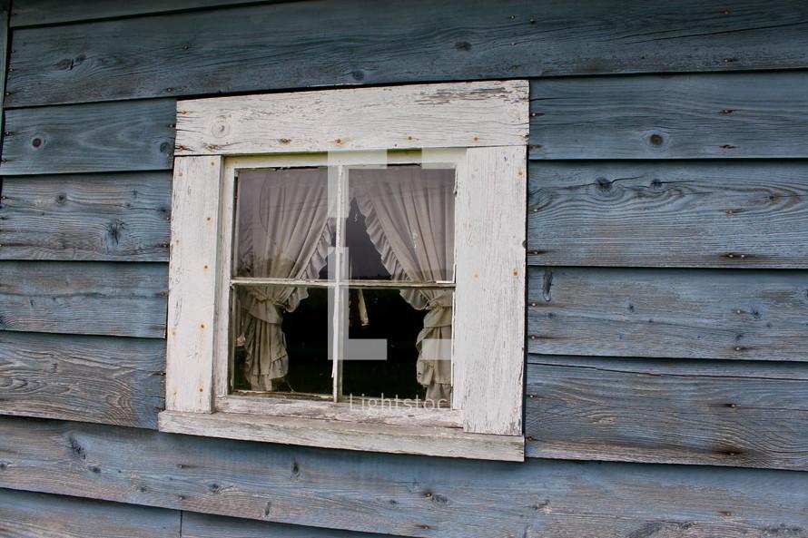 curtains through a small window