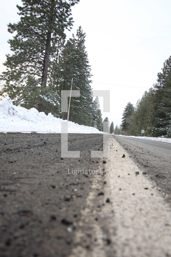 snow on the side of a freshly plowed road
