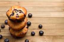 blueberry muffins on a wood background