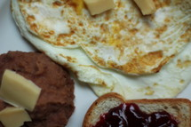 refried beans, eggs, and jam on toast