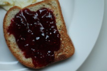 jelly on a slice of toast