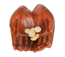 wooden carved hands holding coins