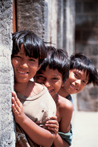 Three little boys smiling {Also try search for 'Ethnic Faces'}