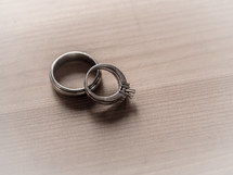 wedding ring and engagement ring on a table