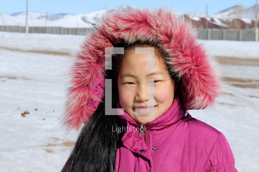 Young Mongolian girl in a winter coat  [For more like this try search Ethnic Faces]
