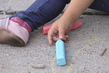 Child's hands with sidewall chalk,