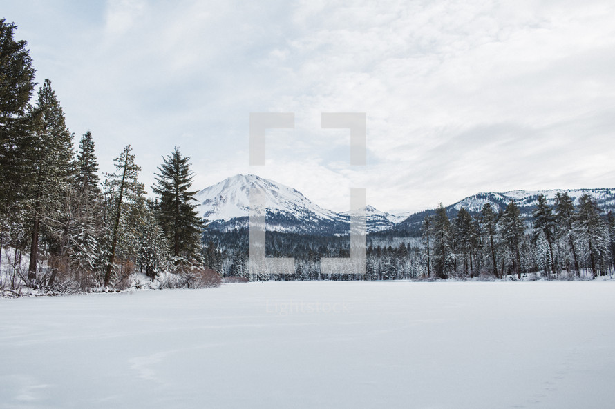 mountain peaks and a snowy meadow