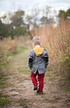 toddler boy walking outdoors