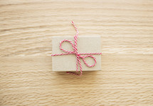 red and white string around a brown paper gift box