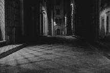 dark narrow empty streets at night in Italy