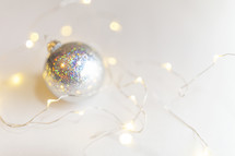 silver ornament and fairy lights