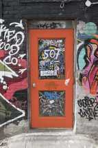 graffiti around a door