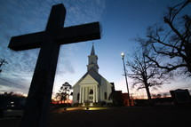 silhouette of a cross Night time country church