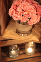 pink carnations in a wooden crate