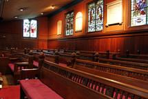 rows of church pews in Trinity Church, Boston