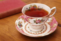 tea cup and saucer and book