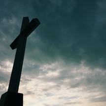 cross silhouette under a gray sky