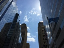 looking up at the sky between city buildings