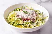 zucchini Squash Being Cut into Pasta Like Twirls for a Healthy Alternative to Pasta