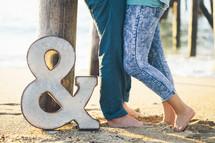 &, couple on a beach