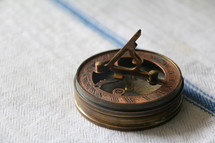 Antique pocket brass compass and sun dial to measure direction, orientation and time