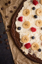 Brownie Dessert Pizza Topped with Fruits and Cream Cheese Frosting