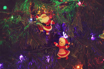 Mr and Mrs Santa Claus ornaments on a Christmas tree