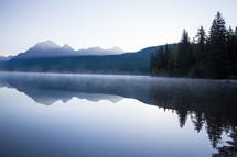 mist over lake at sunrise