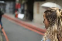 a woman walking down a street