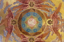 Angels around the white dove of the Holy Spirit, represented in a tile mosaic
