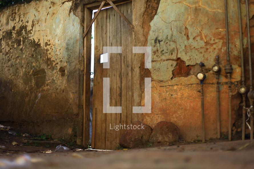 Wooden door and rock wall