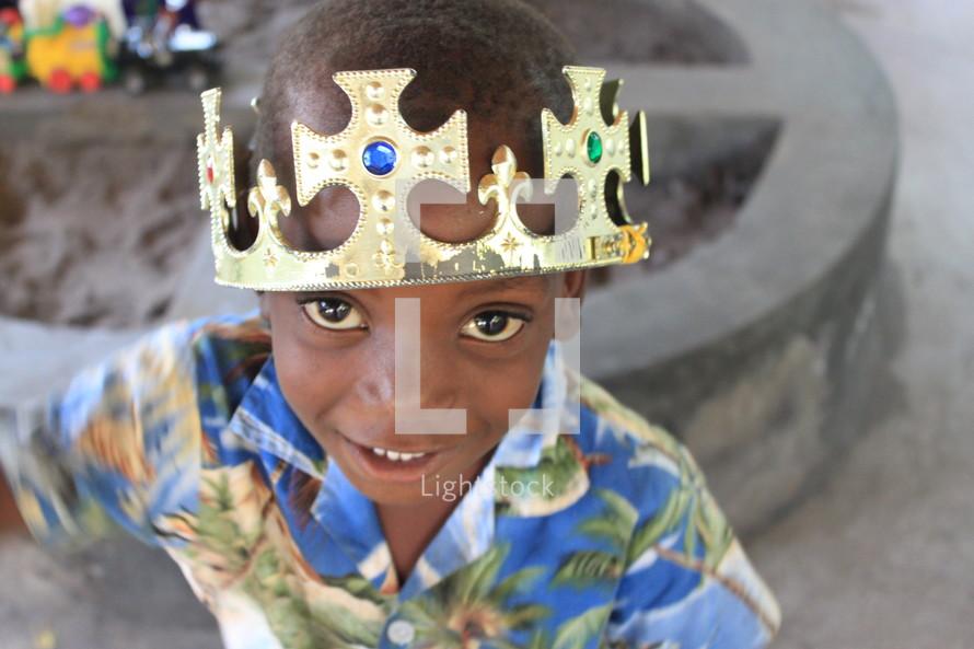 boy child wearing a crown
