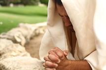 Jesus kneeled in prayer