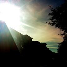 sunburst over a rooftop