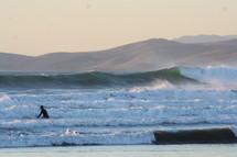 Surfer on surfboard in ocean waves