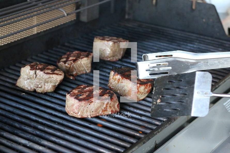 filet steaks on a grill
