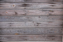 Old wooden planks along the floor of a timber clad house