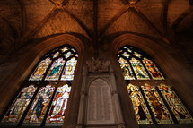 Stained glass windows inside an ancient cathedral.