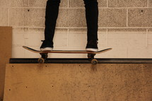 skateboarder on a ramp ledge