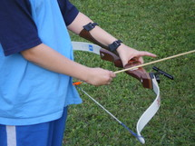 a child shooting a bow and arrow